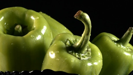 Wet green chili peppers, advertising concept