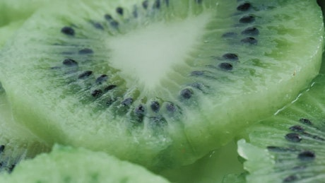 Wet kiwi slices in detail