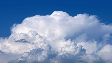 White clouds in motion in a blue sky