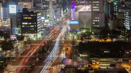 Wide avenue of a big city at night