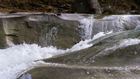 Wild mountain river water flowing