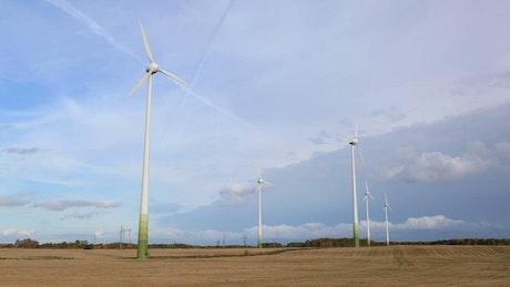 Wind farm in a ploughed field