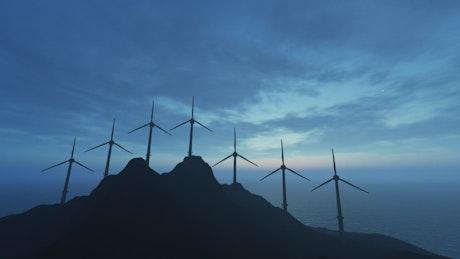 Wind generators on top of a mountain near the sea