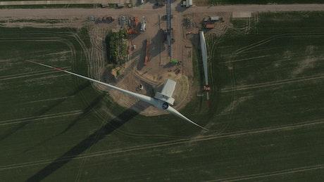 Wind turbine under repair, aerial view