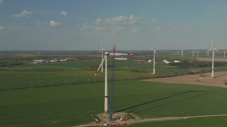 Wind turbine under repair with a crane