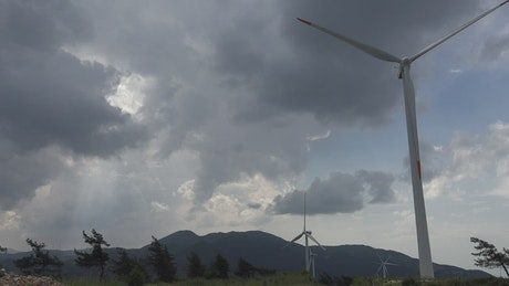 Wind turbines and a cloudy sky