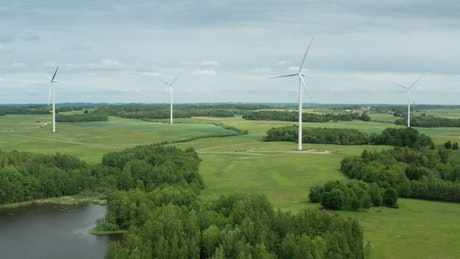Wind turbines next to a natural lake