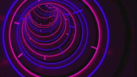 Winding tunnel with neon blue and pink lights