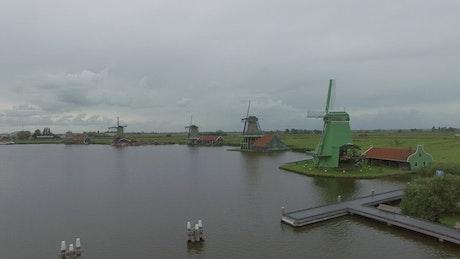 Windmills along a river