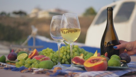 Wine and grapes at the beach
