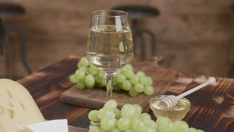 Wine with grapes and cheeses