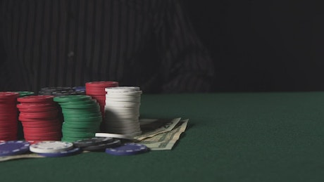 Winner taking the chips from a Poker table