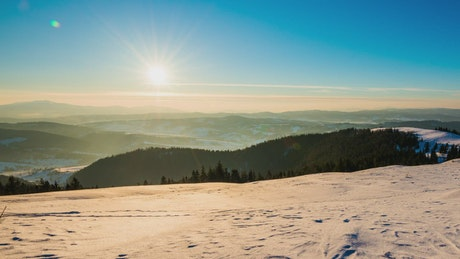 Winter landscape during sunset in the mountains