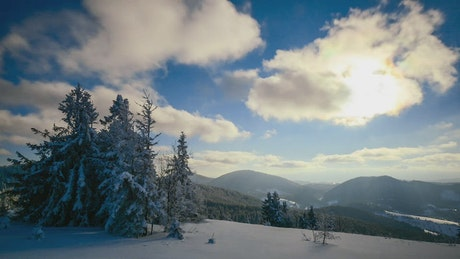 Winter mountains and the sunny sky