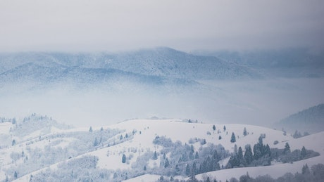 Winter storm in snowy mountains