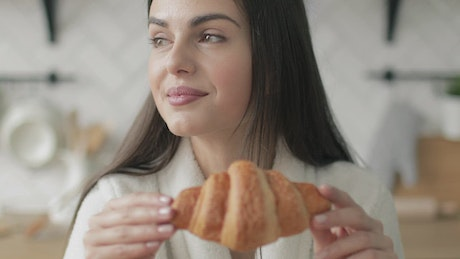 Woman about to eat bakery