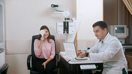 Woman and an ophthalmologist during an eye exam