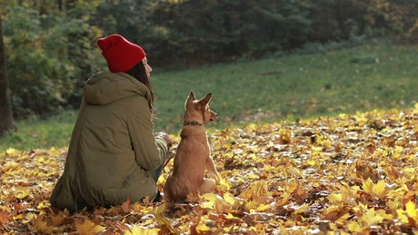 Woman and her dog outside