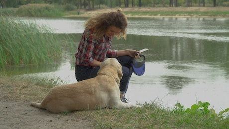 Woman and her dog spending time together