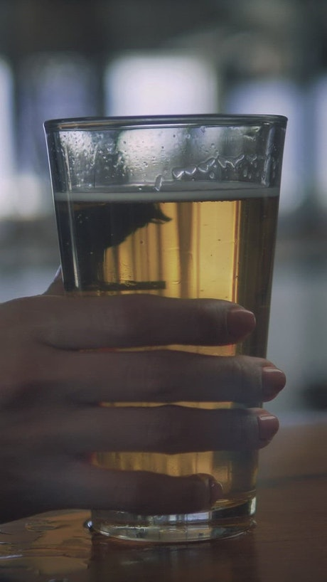 Woman and her glass of beer