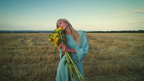Woman and sunflowers in the countryside