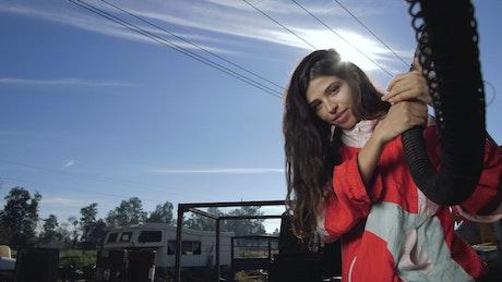 Woman at junkyard