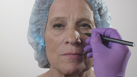Woman being prepared for cosmetic surgery