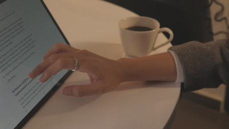 Woman browsing a news page on a tablet