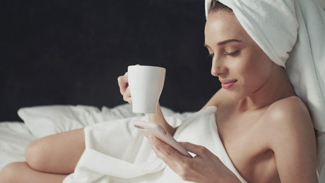 Woman browsing social media after shower