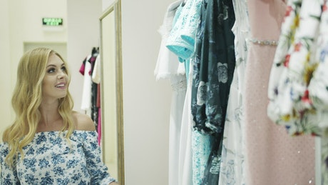 Woman buying dresses in a store