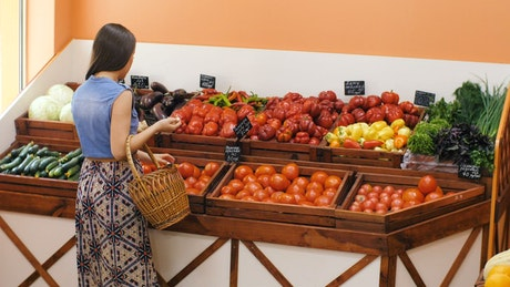 Woman buying tomatoes in the market
