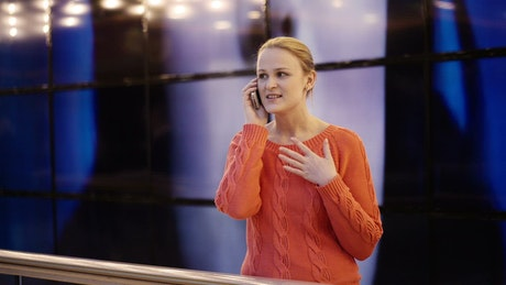 Woman chatting on a telephone