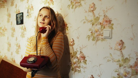 Woman chatting on an old phone