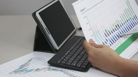 Woman checking a graph at work