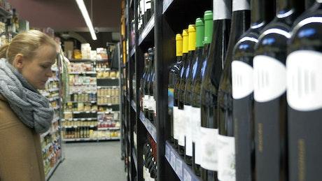 Woman choosing a bottle of wine