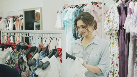 Woman choosing clothes in a store