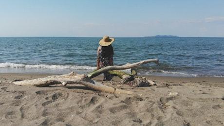 Woman contemplating the ocean