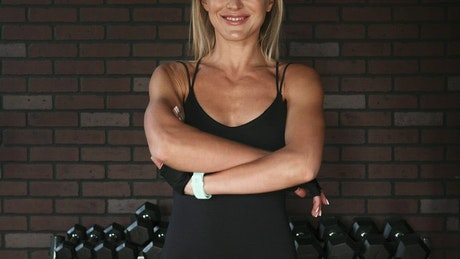 Woman crossing her arms after a workout