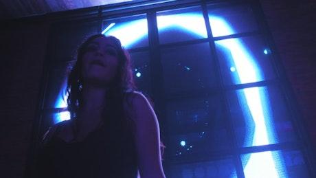 Woman dancing alone in the club