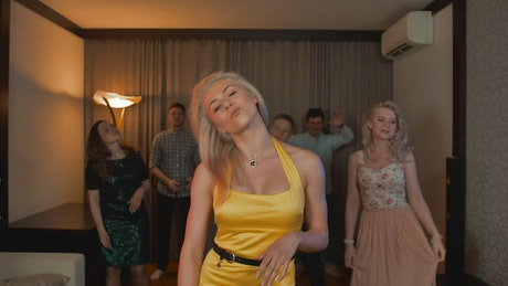 Woman dancing with her friends at a home party