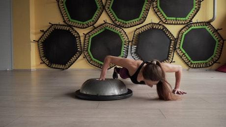 Woman doing flip push ups