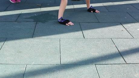 Woman doing push ups outside