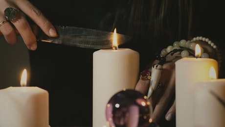 Woman doing the magic ritual with a candle