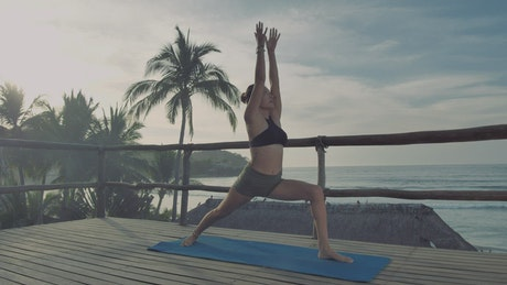 Woman doing yoga on a deck