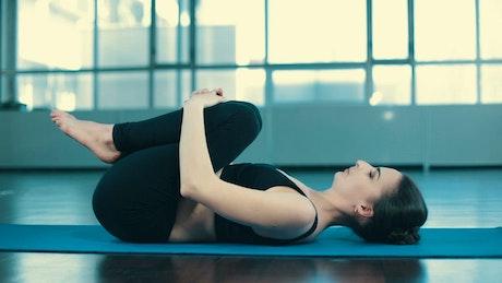 Woman doing yoga warm-up
