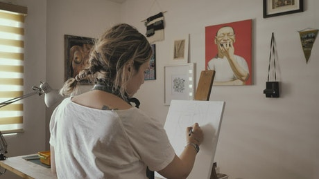Woman drawing baselines on a white canvas