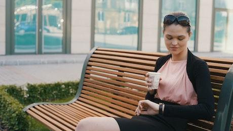 Woman drinking coffee on a break