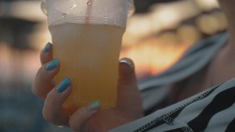 Woman drinking cold lemonade