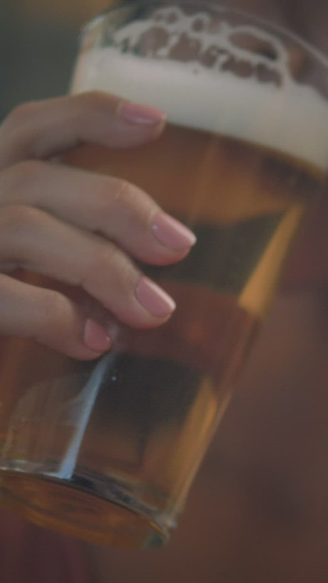 Woman drinking craft beer from a glass