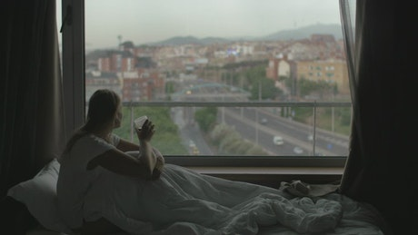Woman drinking in bed